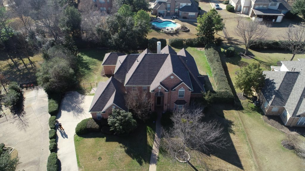 Two story brick house in Southlake, TX with GAF Timberline HD shingles installed on roof
